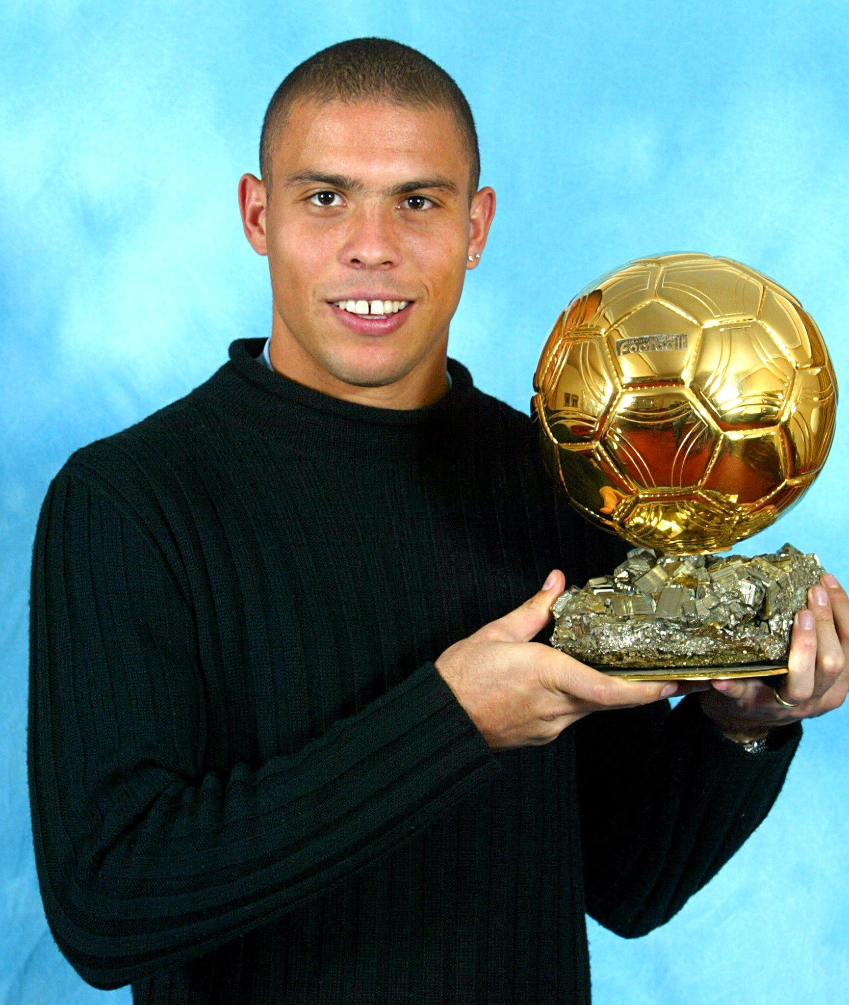 Posing with the Ballon d'Or in a black fleece. Iconic