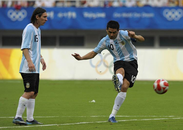 A young Lionel Messi learning from the best at the 2008 Olympics