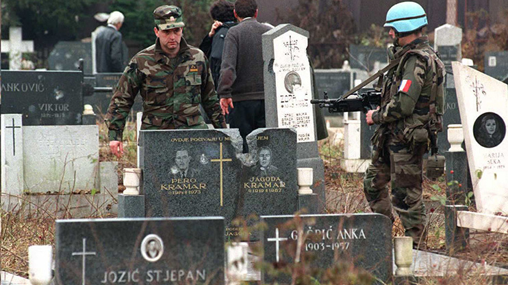 Bosnia soldiers visit the graves of comrades during the Yugoslav wars