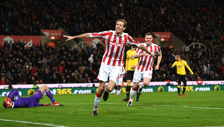 STOKE ON TRENT, ENGLAND - JANUARY 03: Peter Crouch of Stoke City celebrates scoring his team