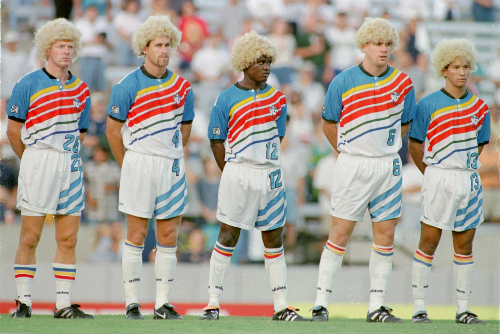 18 Jul 1996: Members of the Kansas City Wiz (#26 Mo Johnston, #4 Scott Uderits, #12 Digital Takawira,#6 Sean Bowers, #13 Mark Chung ) wear wigs before the Tampa Bay versus Kansas City MLS game in Tampa, Florida. They were wearing wigs that were given out to the first 1,000 fans to help celebrate Carlos Valderrama day. Valderrama is known both for his excellant soccer and very floppy hair syle. Mandatory Credit: ANDY LYONS/ALLSPORT
