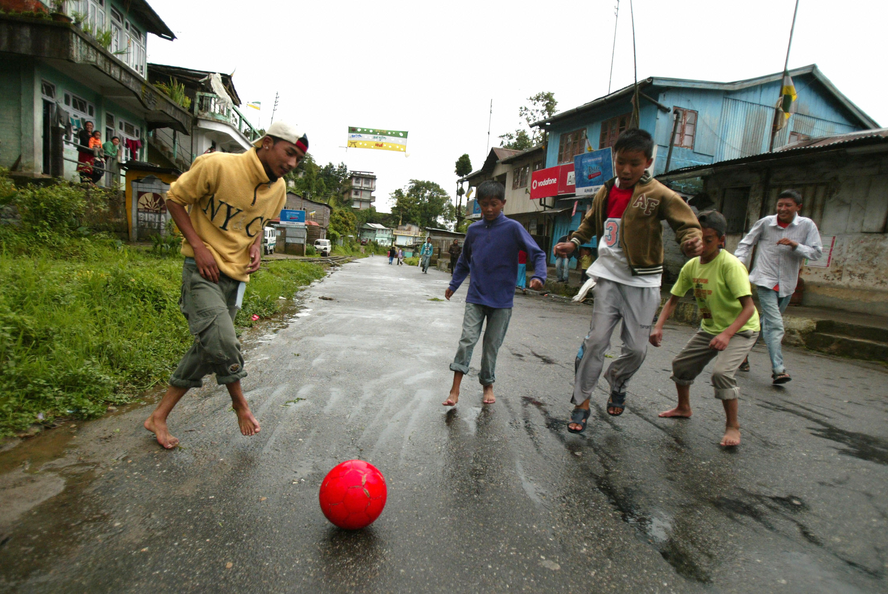 Indian children play football on a deserted road in Darjeeling on June 17, 2008, during first day of an indefinite strike in the Darjeeling Hill area. The The Gorkha People