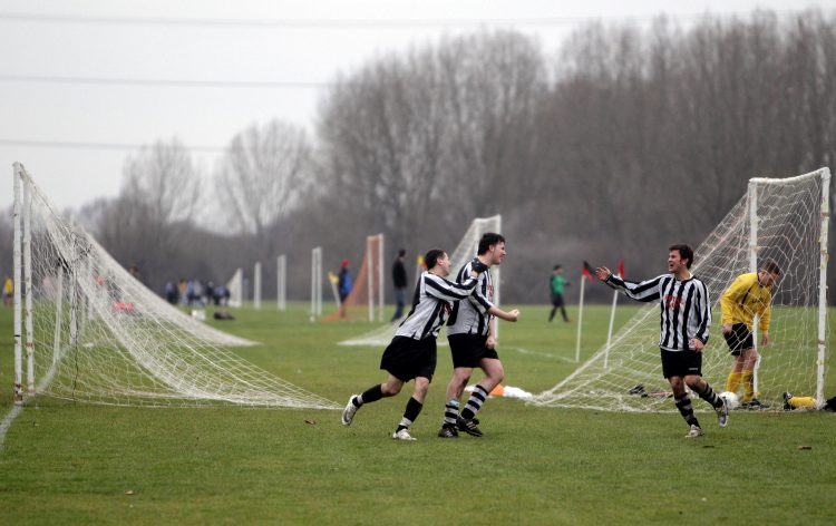 LONDON, ENGLAND - JANUARY 24: Sunday League footballers celebrate a goal during a match on the Hackney Marshes