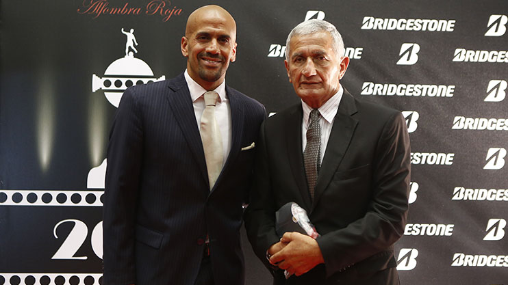 ASUNCION, PARAGUAY - DECEMBER 2: Juan Sebastian Veron President of Estudiates and his father Juan Ramon Veron former player of Estudiantes pose for pictures on the red carpet before the Official Draw of the 56th Copa Bridgestone Libertadores at Conmebol Convention Center on December 2, 2014 in Asuncion, Paraguay. (Photo by Gabriel Rossi/LatinContent/Getty Images)