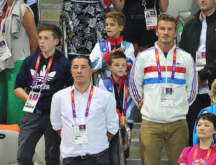 LONDON, ENGLAND - AUGUST 11: David Beckham and his sons Brooklyn Beckham, Romeo Beckham and Cruz Beckham meet members of Team GB the Men
