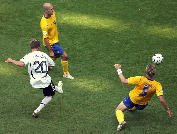 German forward Lukas Podolski (L) scores