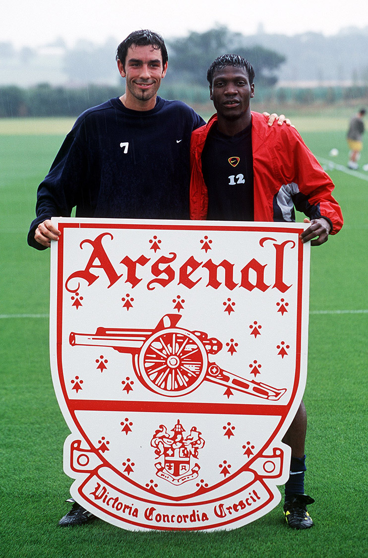 Robert Pires poses with Lauren and the Arsenal crest after joining from Marseille in 2000
