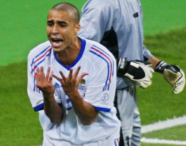 David Trezeguet of France (L) reacts in front of U