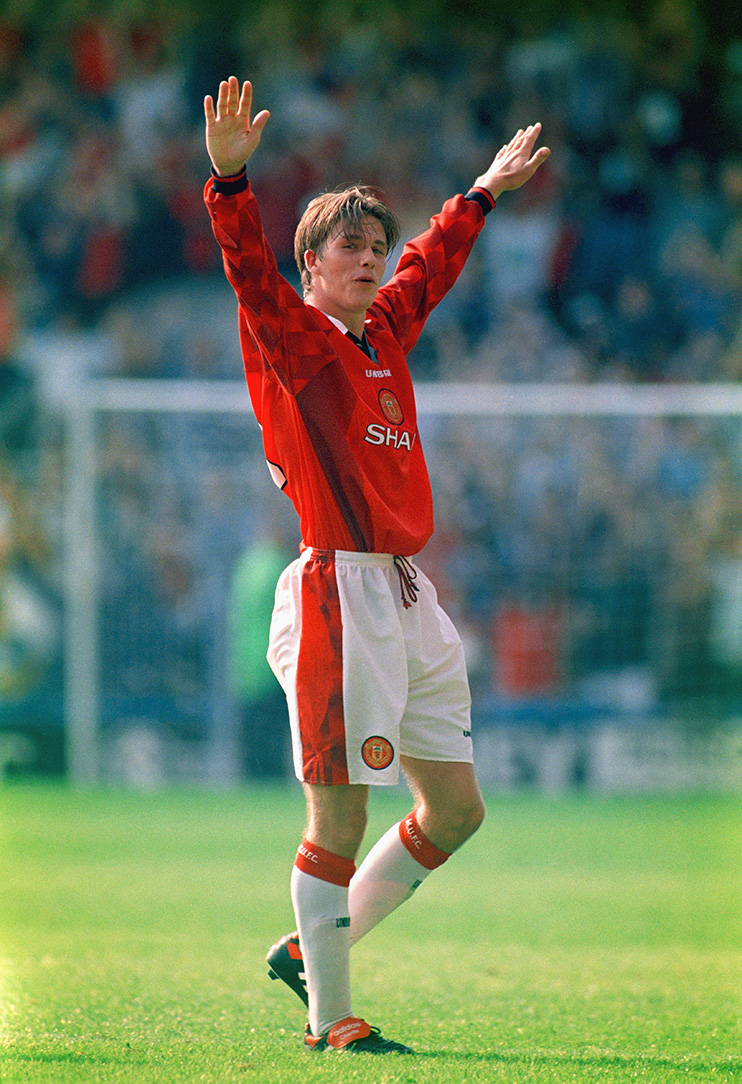 LONDON, UNITED KINGDOM - AUGUST 17: Manchester United player David Beckham celebrates after scoring the third goal with a spectacular effort from the halfway line, during the Premier League match between Wimbledon and Manchester United at Selhurst Park on August 17, 1996 in London, England. (Photo by Michael Cooper/Getty Images)