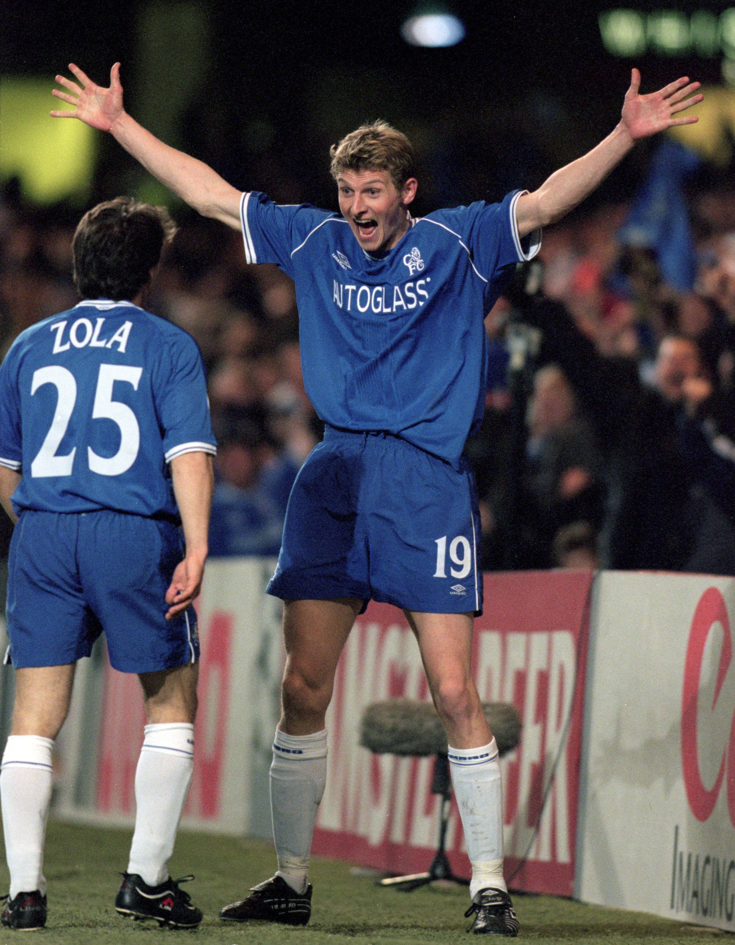 Tore Andre Flo clebrates with Gianfranco Zola of Chelsea after scoring