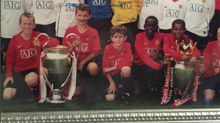 A young Rashford poses with the Premier League trophy