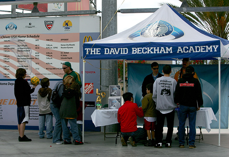CARSON, CA - JANUARY 27: People stand around The David Beckham Academy booth during the Open House for season ticket sales at the Home Depot Center on January 27, 2007 in Carson, California. (Photo by Harry How/Getty Images) *** Local Caption *** David Beckham