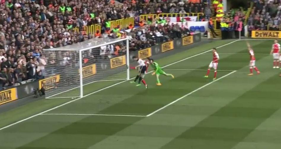 With the goal at his mercy, Alli meets the ball under pressure from Alex Oxlade-Chamberlain