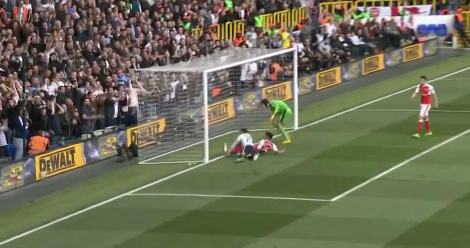 The ball somehow drifts wide of the post to the bemusement of the White Hart Lane faithful