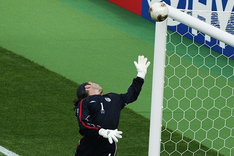 David Seaman is beaten by Ronaldinho's free-kick in England's 2-1 defeat to Brazil