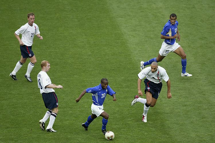 Edilson evades the attention of three England players