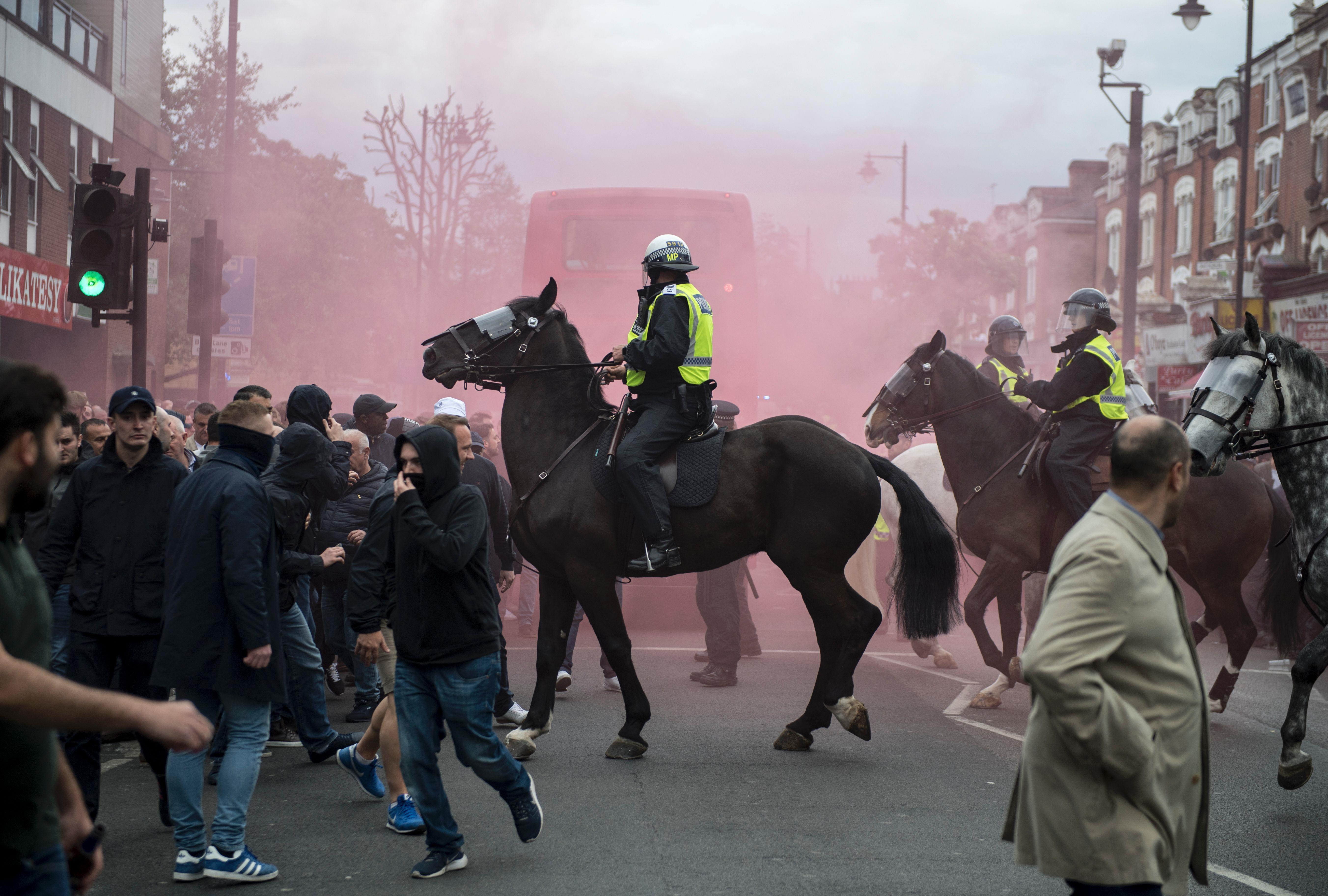 Mounted police eventually separated the rivals fans