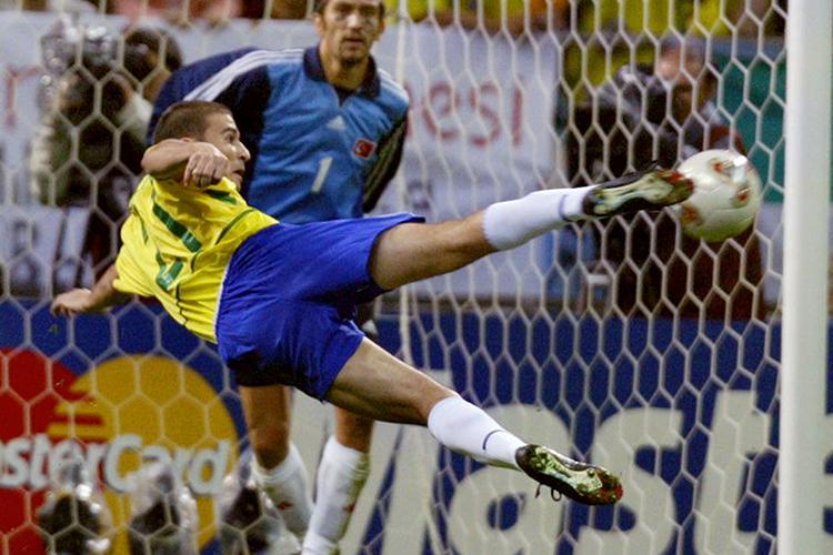 Luizao attempts an acrobatic effort against Turkey