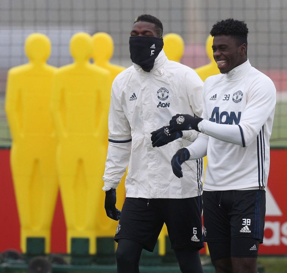 Axel Tuanzebe, pictured with Paul Pogba, has joined in first team training with United