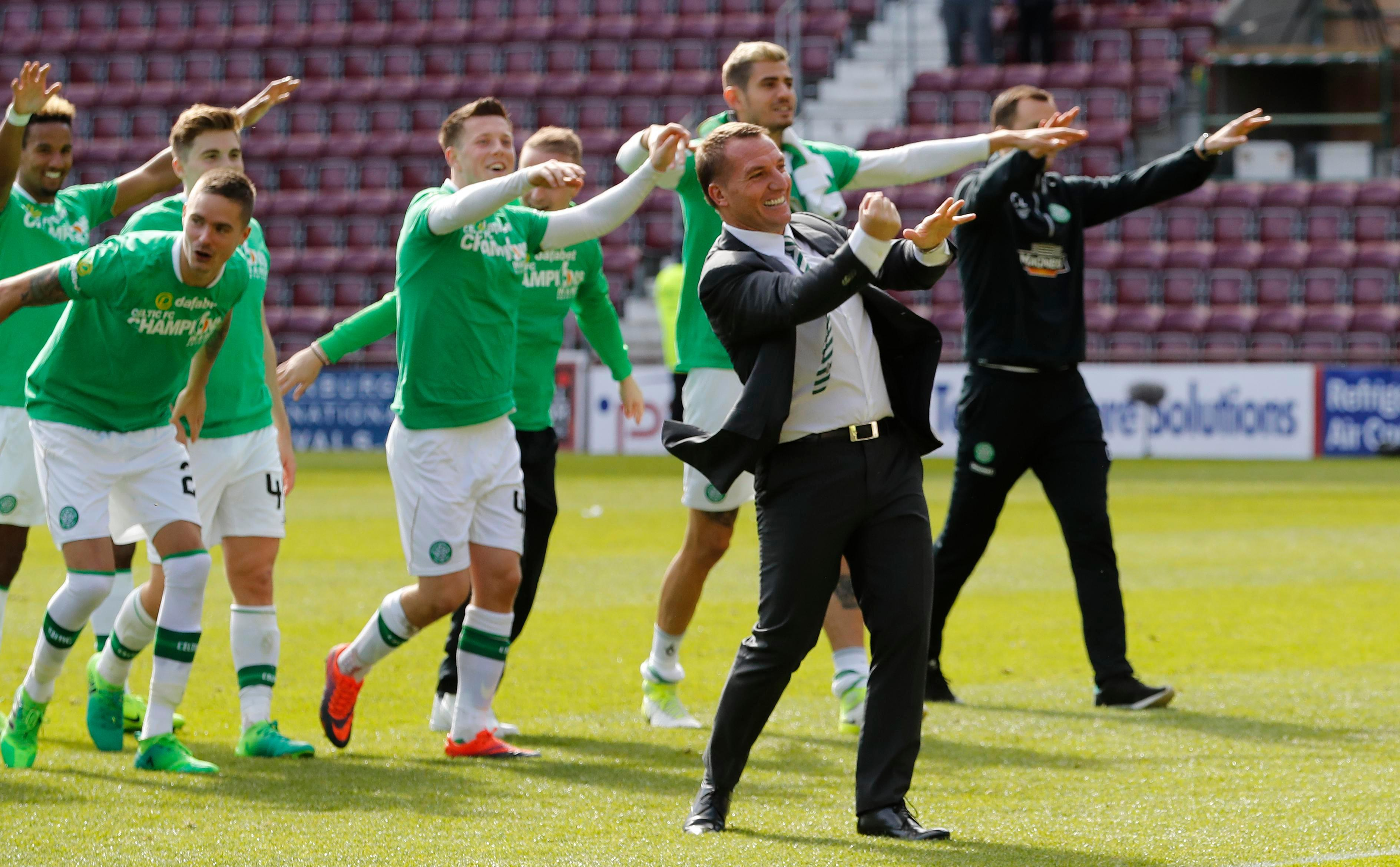 Brendan Rodgers and his Celtic team celebrate their title success