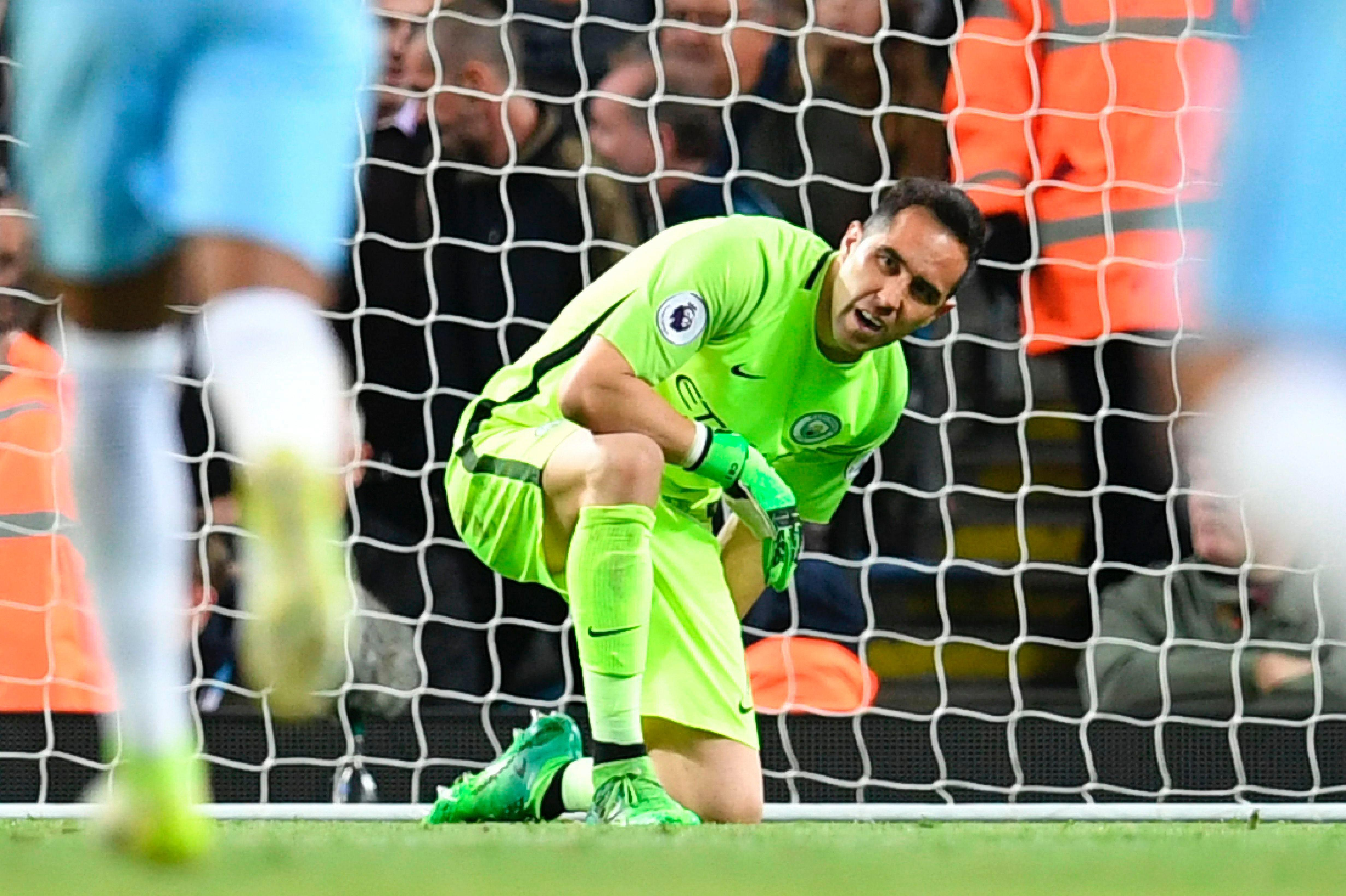 Claudio Bravo came to collect a corner but hurt himself while landing