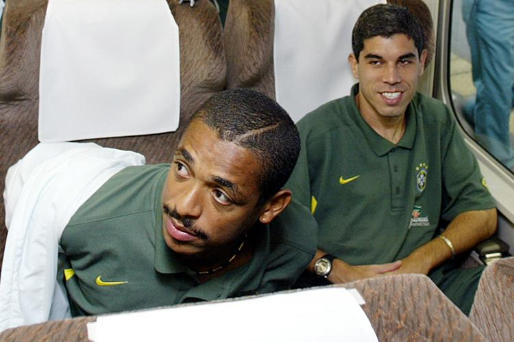 Vampeta (left) sitting next to team-mate Ricardinho