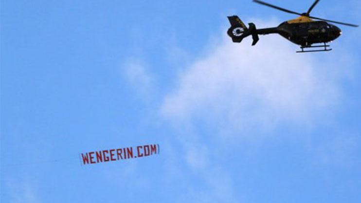 WENGERIN.COM banner seen flying over the Etihad before kick off