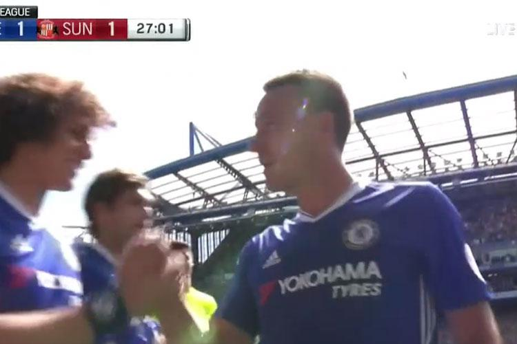 Here he is shaking hands with David Luiz