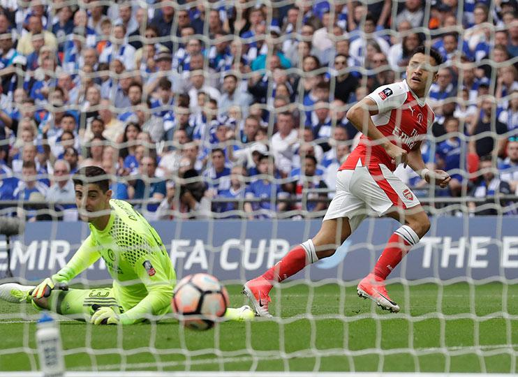 Alexis Sanchez slots home past Thibaut Courtois in the opening stages to give Arsenal the lead