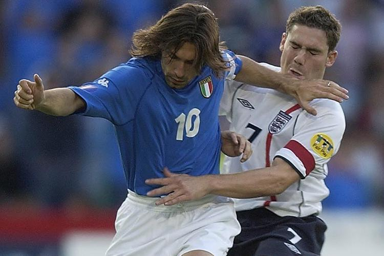 One of the finest midfielders to play the modern game tries to tackle Pirlo