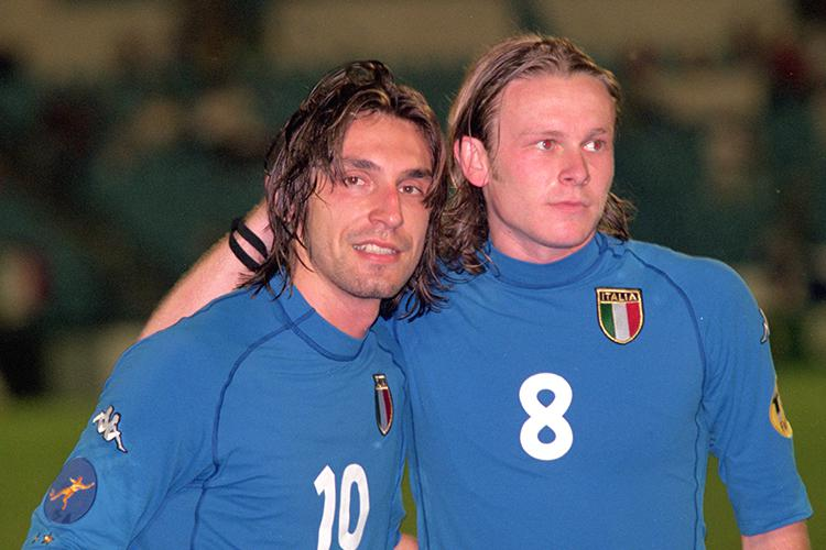Pirlo posing with Roberto Baronio who played exactly one game for Italy