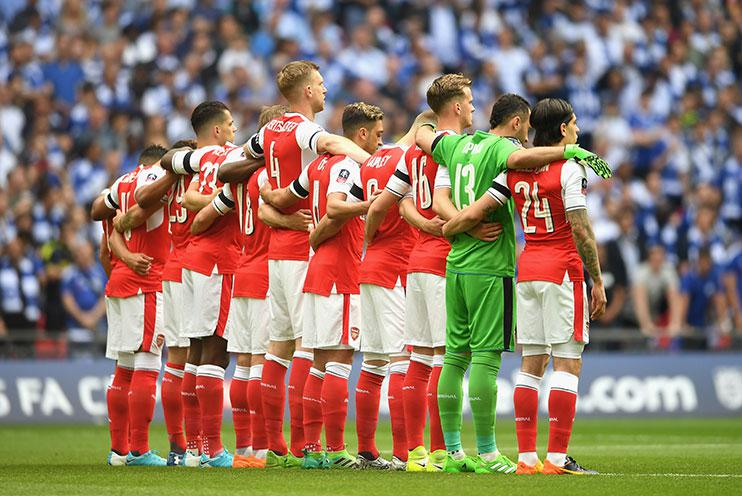 Arsenal's players donned black armbands for the minute's silence…