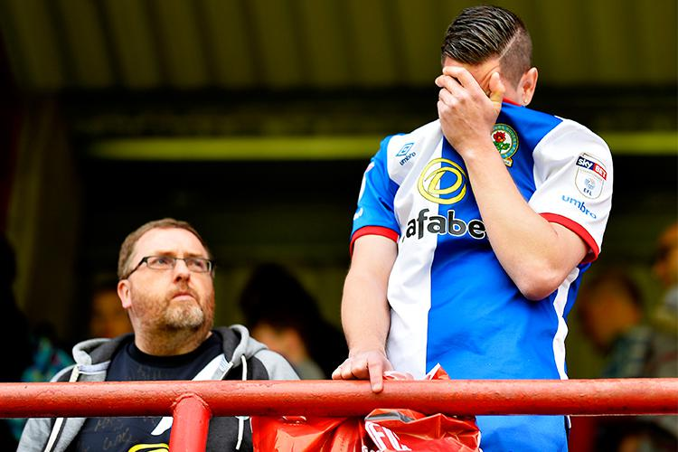 A Blackburn Rovers fan can't hold back the tears after his side's relegation