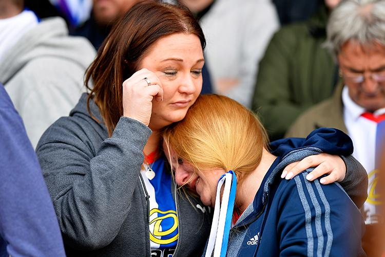 Blackburn fans console each other after the despair of relegation