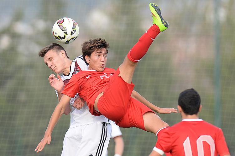That's one way to try a bicycle kick