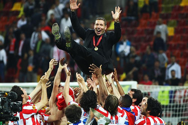 Simeone is thrown in the air by his players after winning the 2012 Europa League