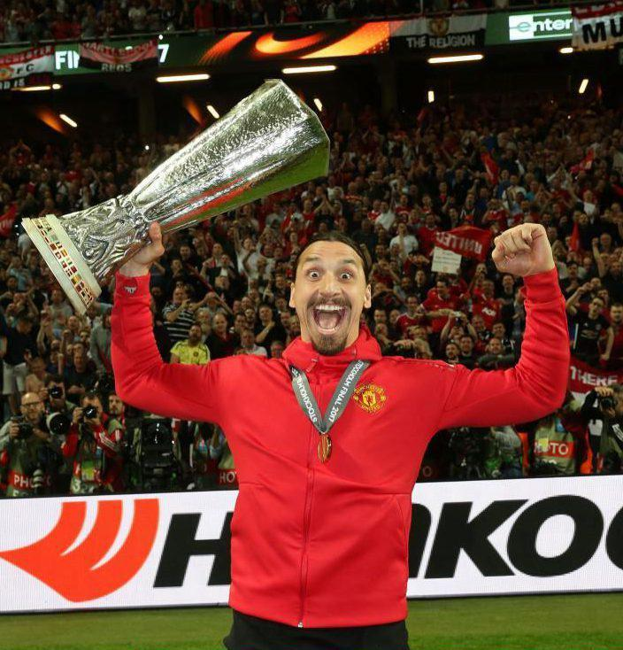 Zlatan Ibrahimovic celebrates with United's Europa League trophy