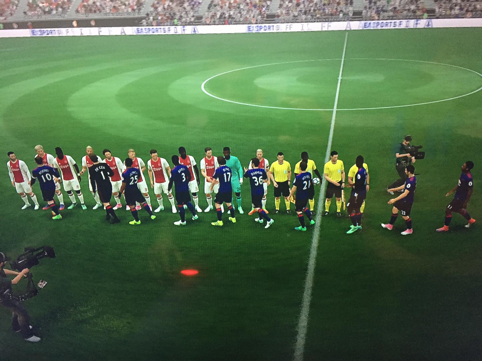 The teams shake hands before kick off – United are clearly up for the game and look to attack from the off