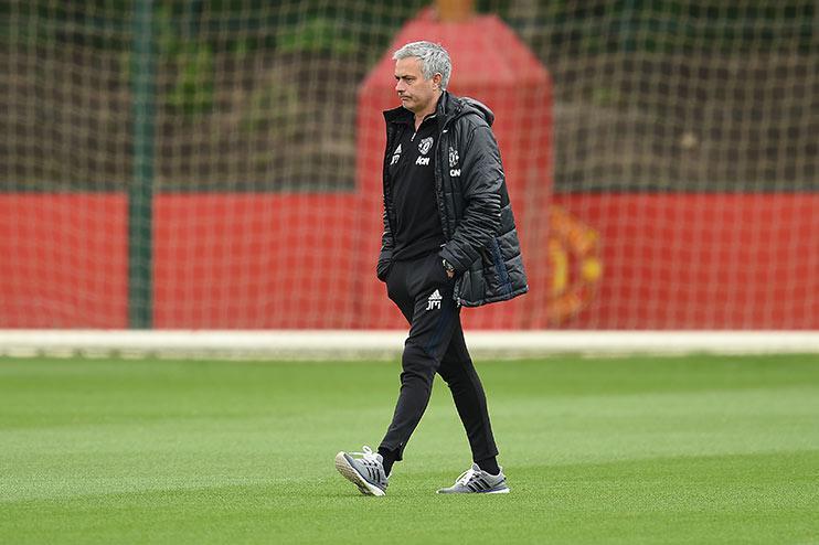 Jose Mourinho, walking… obviously.