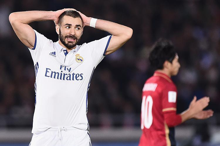 Benzema has just heard that Ronaldo and Bale are on the team sheet