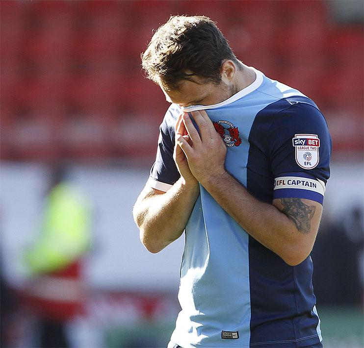 Leyton Orient's Tom Parkes leaves the pitch after Orient's relegation to the National League is confirmed.