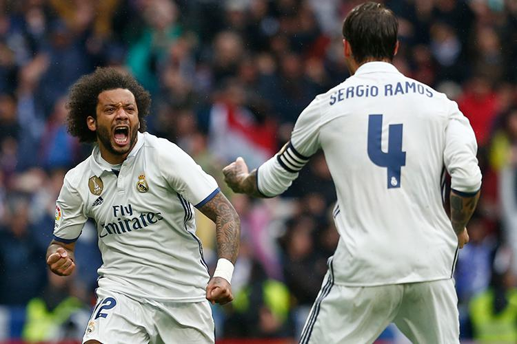 Sergio Ramos tries to stop Marcelo going on another forward run