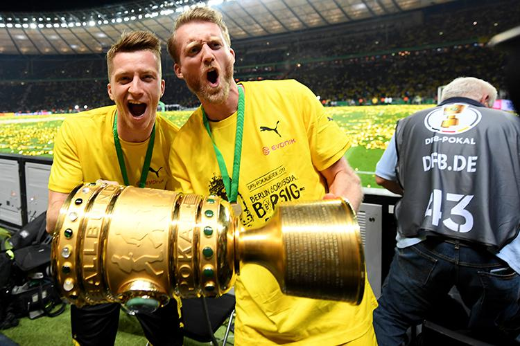 Despite his injury Reus was still able to celebrate the cup success