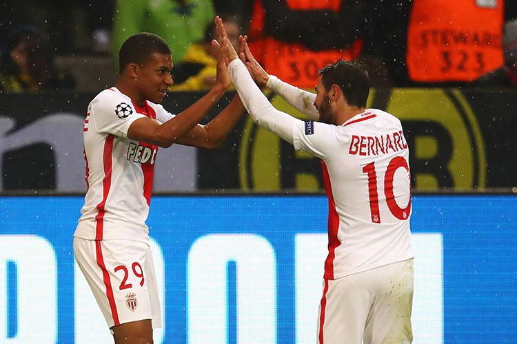 Kylian Mbappe and Bernardo Silva celebrate their passage into the Champions League semi-final