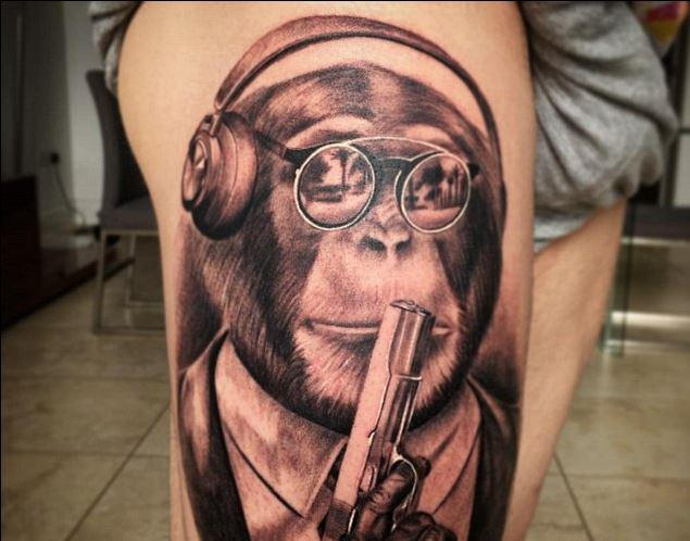 We've all thought about getting a music-loving, near-sighted, smartly-dressed monkey assassin tattooed on us at some point in our lives