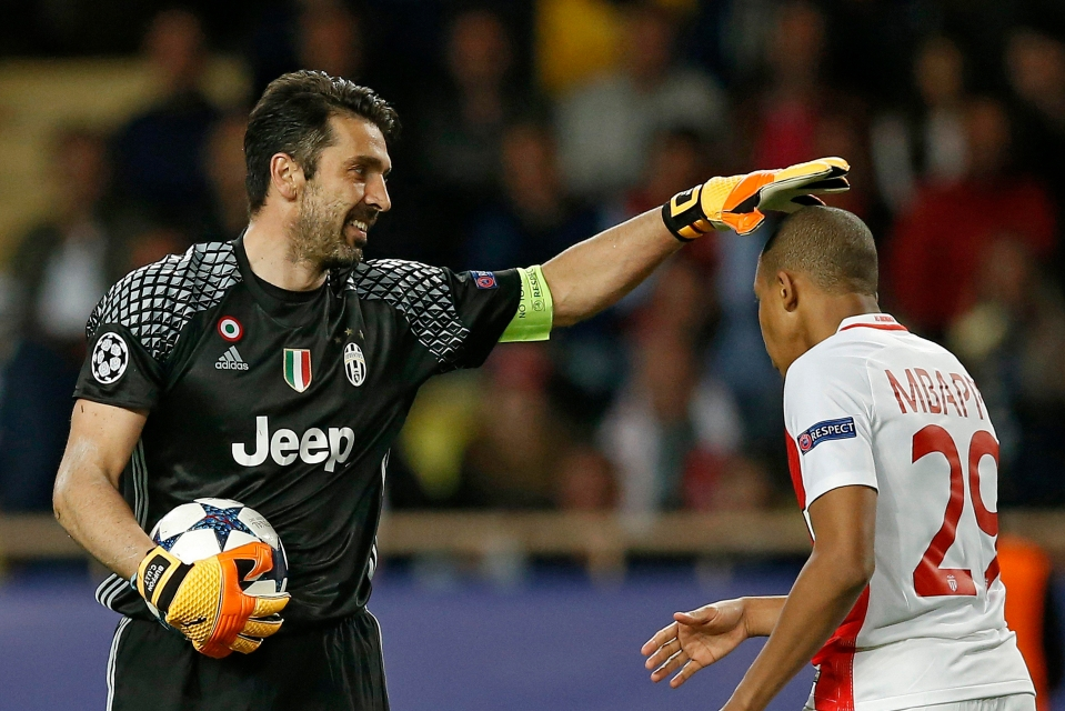 Buffon and Mbappe share a moment
