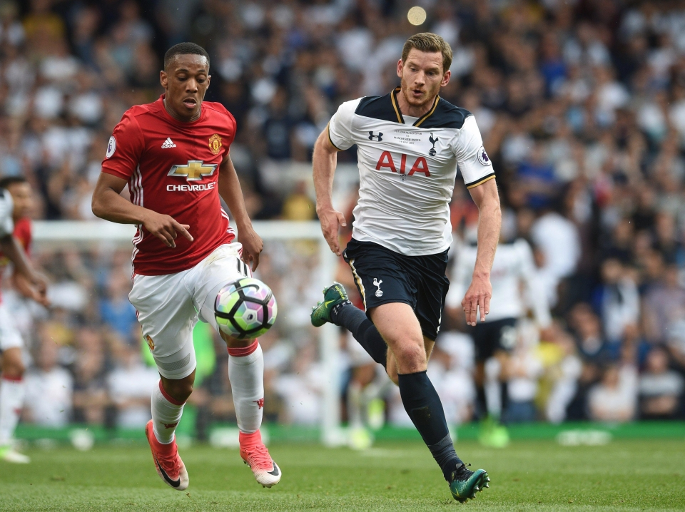 Jan Vertonghen competes with Anthony Martial for the ball