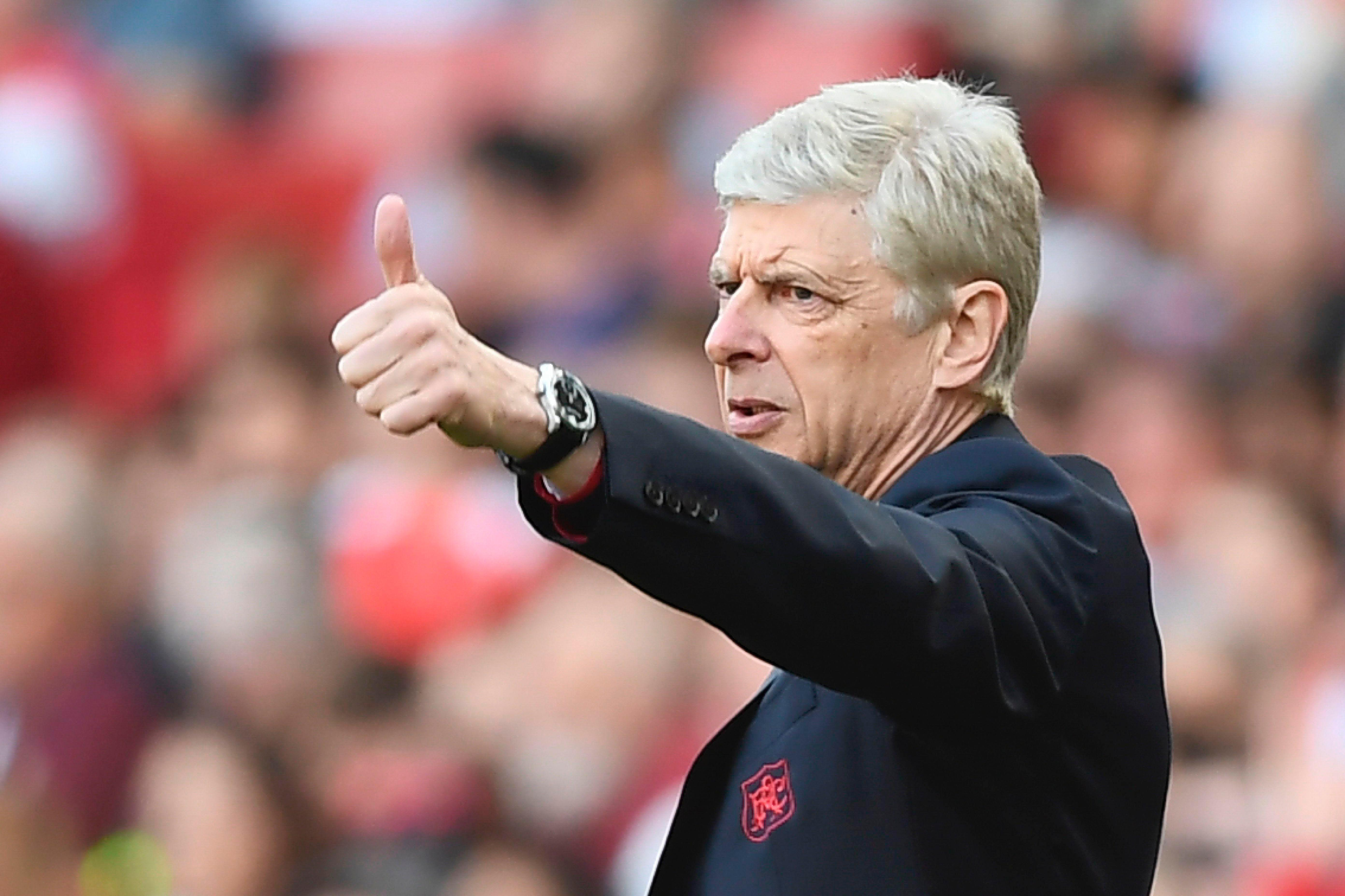 Will Arsene Wenger be giving the thumbs up to Arsenal fans by staying on?