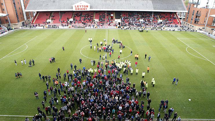 Leyton Orient fans protest against owner Francesco Becchetti after their relegation to the National League.