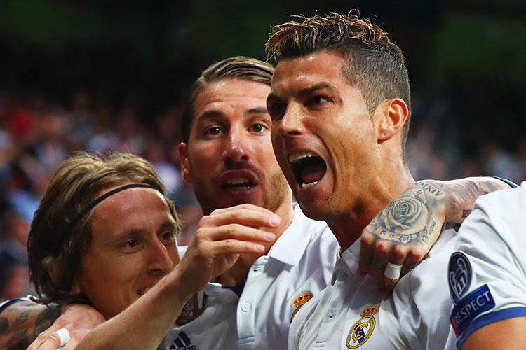 Ronaldo celebrates his third goal with his teammates